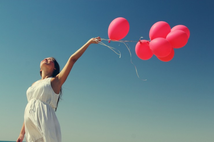 beautiful-girl-with-red-balloon-at-blue-sky-background-picture-id187206751